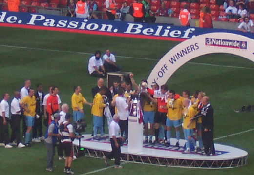 Lifting the trophy 1