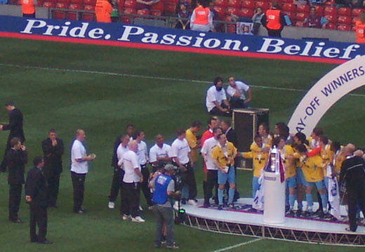 Lifting the trophy 2