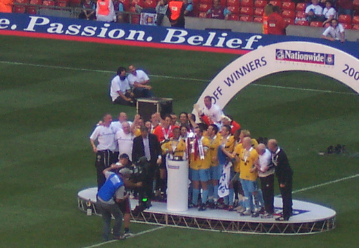 Lifting the trophy 3